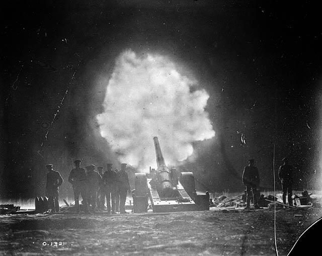 Naval gun firing over Vimy Ridge behind Canadian lines at night. May, 1917