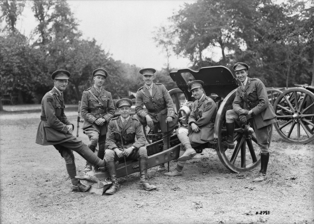Officers of 48th Battery, Canadian Field Artillery with one of their guns. June 1918