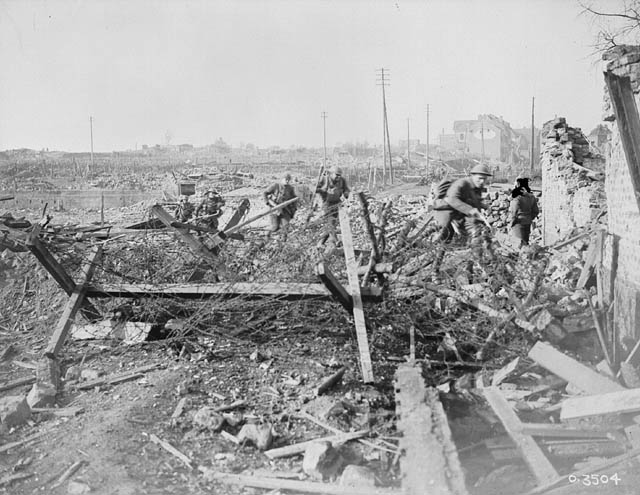 The first Canadian platoon to enter Valenciennes from the west, advancing towards the Canal. (item 1)