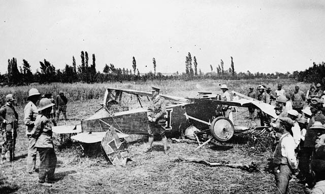 Captain W.G. Barker with wreckage of Fokker D.VII aircraft. (item 1)