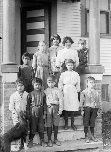Aboriginal students on the steps of an Indian School near Woodstock. (item 1)