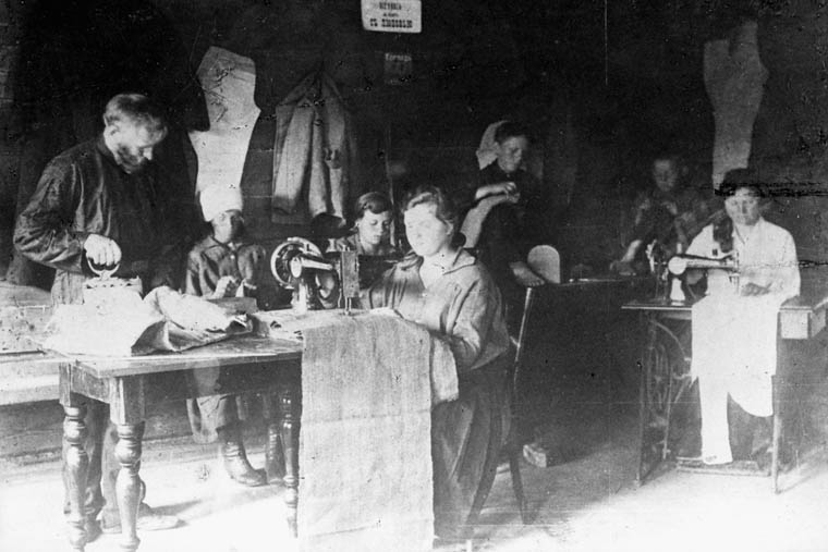 A communal sewing room. Clothing was standardized and issued periodically to every member of the community. (item 1)