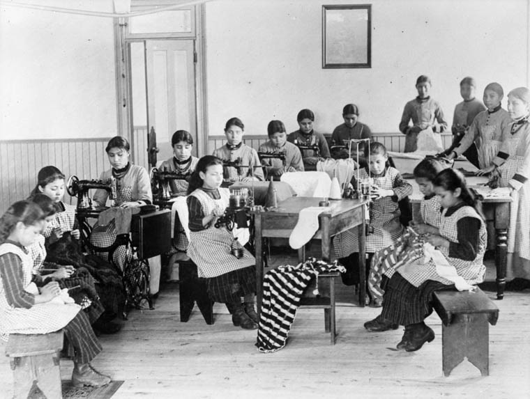 Fort Resolution Indian Residential School (St. Joseph's Convent), group of students in a sewing class,  date unknown