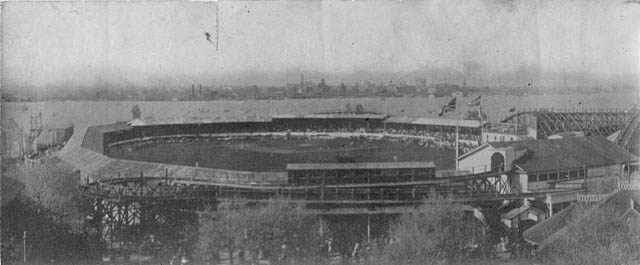 Historic photo from 1908 - Hanlans Point Athletic Field with city in the background in Toronto Island