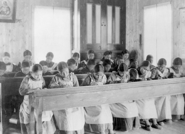 Fort Resolution Indian Residential School (St. Joseph's Convent), students working at rows of desks in a classroom, date unknown