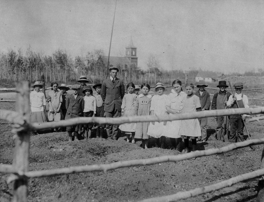 Teaching in Komarno School, Man. (garden making with students) 1917. (item 1)