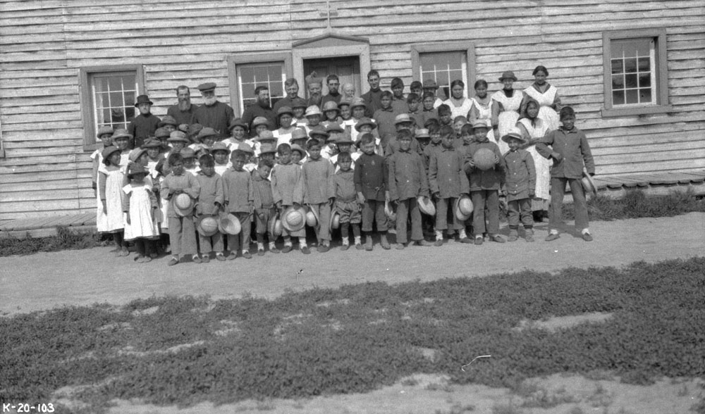 Fort Providence Indian Residential School, students and school personnel posing in front of the school, ca. 1920