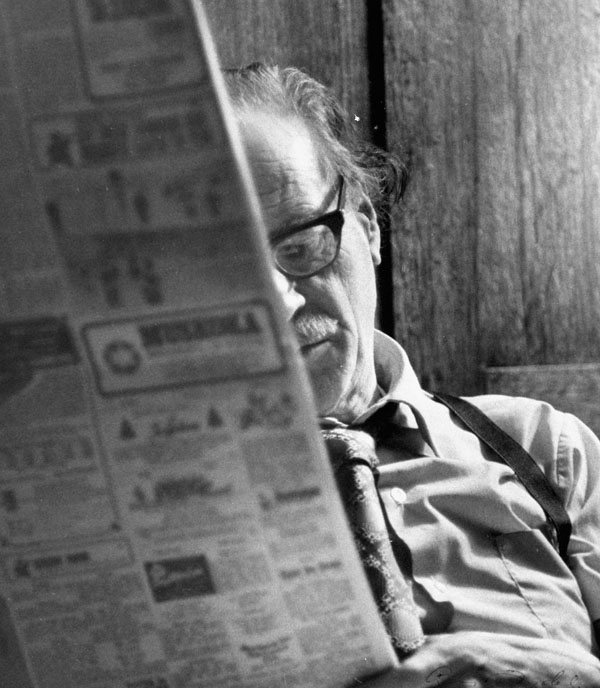 Herbert Marshall McLuhan reading newspaper - apropos for taping piece Electric media volume. (item 1)