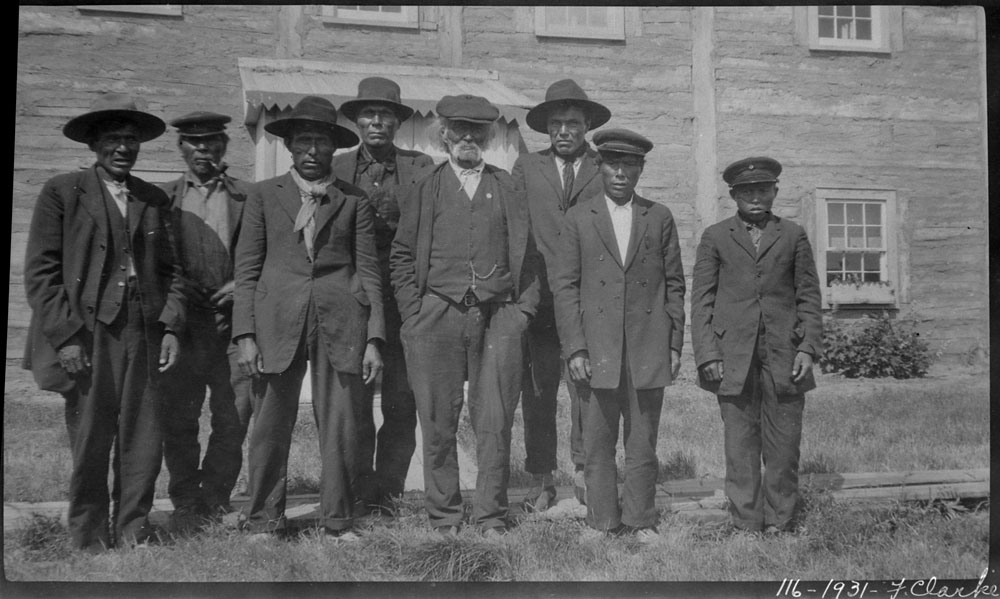 St. David's Mission Indian School, group of First Nations men and an adolescent boy posing in front of the school, Fort Simpson, 1931