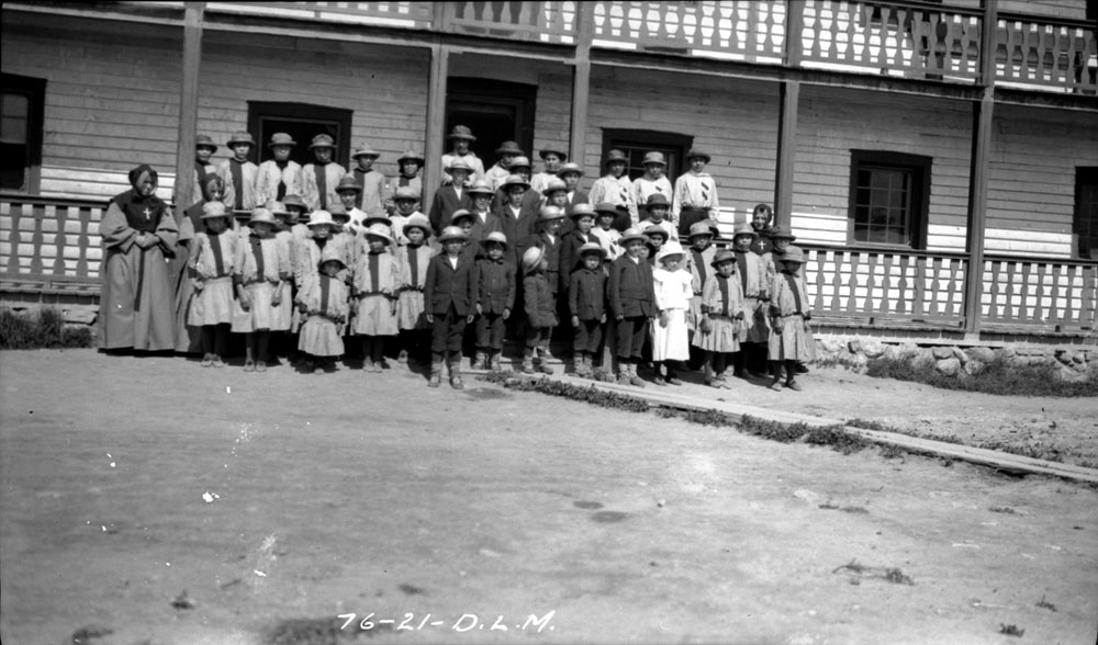 Fort Providence Indian Residential School, students and school personnel posing in front of the school, 1921