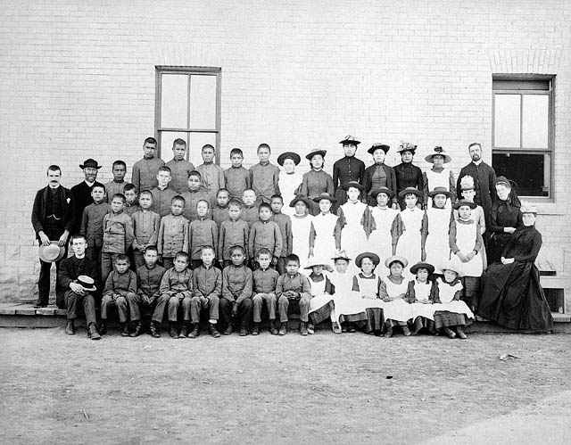 St. Paul's Indian Industrial School, students and staff, Middlechurch, ca. 1901