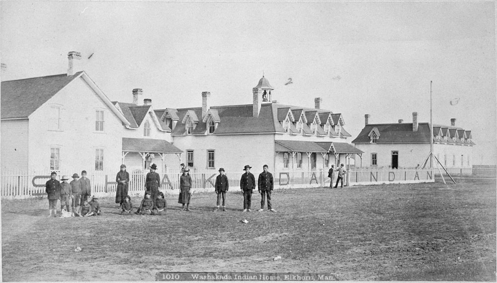 Washakada Indian Residential School, a group of students posing in front of buildings, Elkhorn, ca. 1900