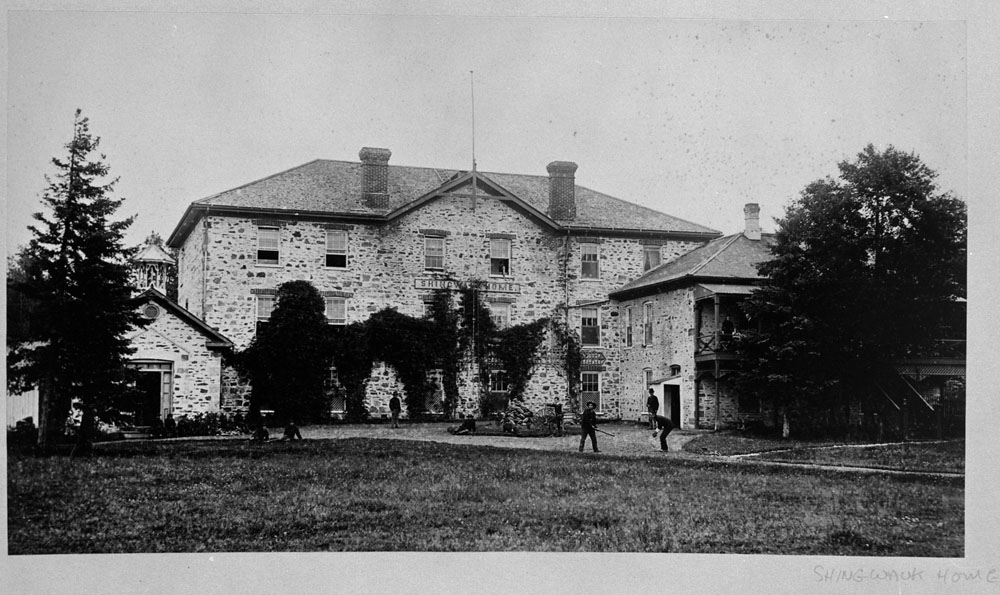 Shingwauk Indian Residential School, boys playing baseball on the lawn in front of the school, Sault Ste. Marie, ca. 1885