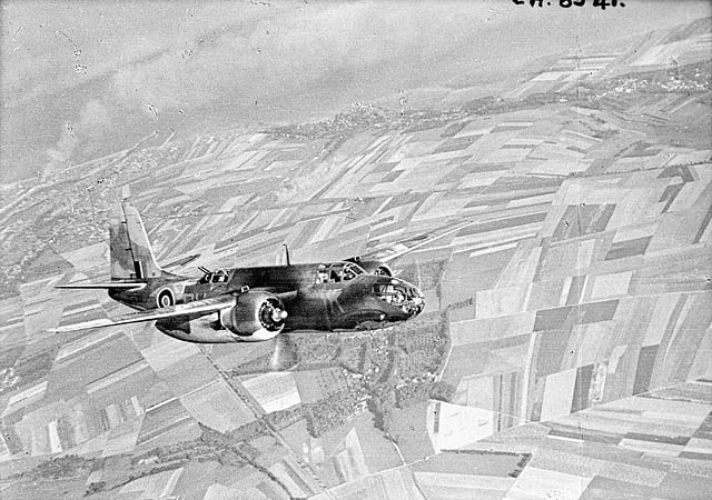 Plane in flight over the fields of France