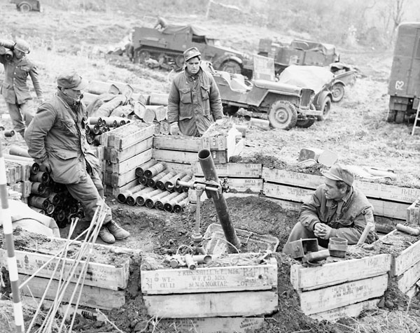 The Royal 22e Regiment mortar platoon ready to fire, (left to right) Private Daniel Primeau, Private Raymond Romeo, and Private Julien Blondin, all of Montreal, Quebec.