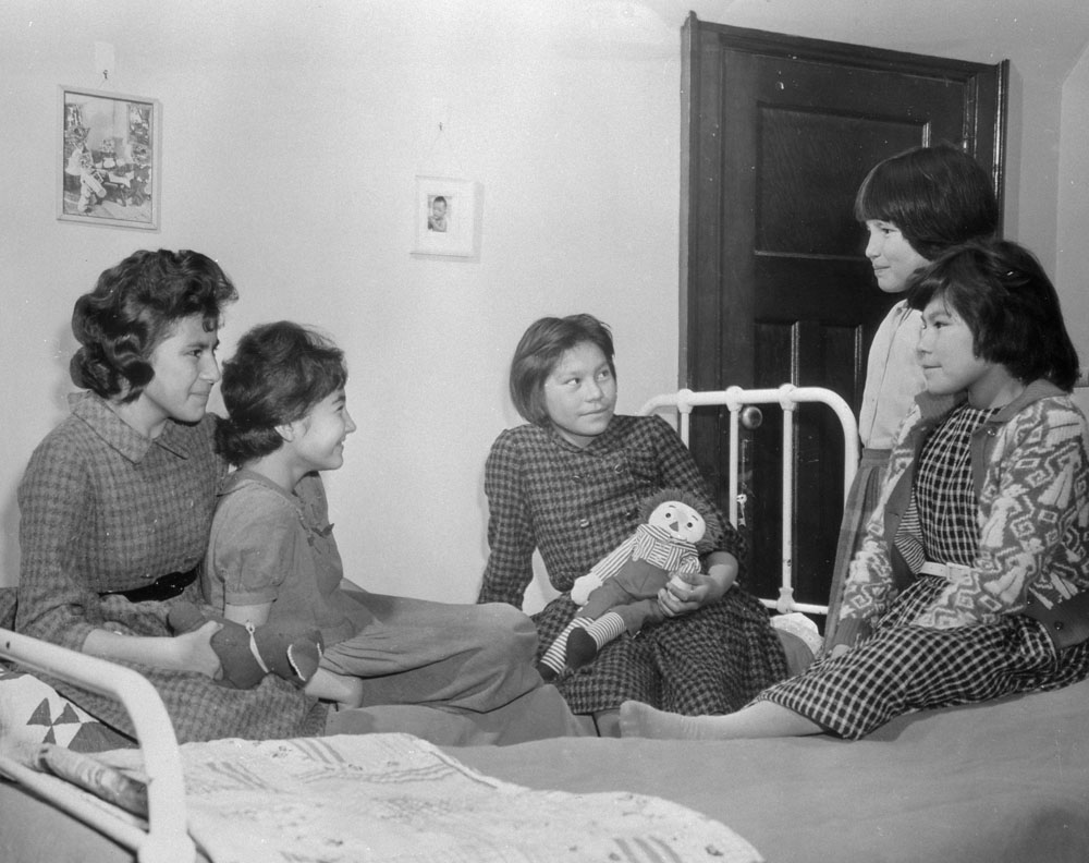 Shingwauk Indian Residential School, five girls in their dormitory, Sault Ste. Marie, ca. 1960