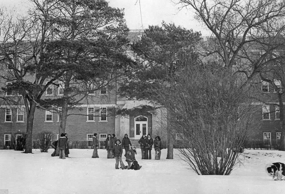Fort Qu'Appelle Indian Residential School, group of students in front of the school, Lebret, March 1973