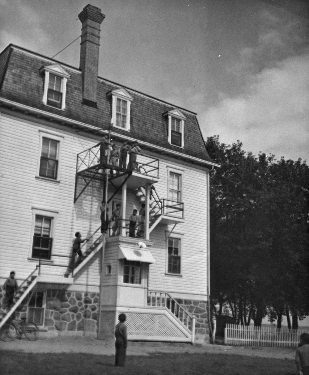 St. Frances Indian Residential School (St. Margaret's Indian Residential School), boys playing on a fire escape of the school, St. Frances, ca. 1958