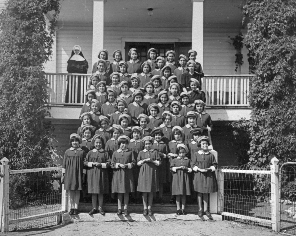 St. Anthony's Indian Residential School, female students and a nun, Onion Lake, ca. 1950