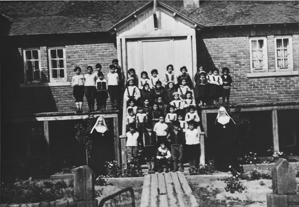 Maliotenam Indian Residential School, children and nuns in front of the school, Sept-Îles, Quebec, ca. 1950