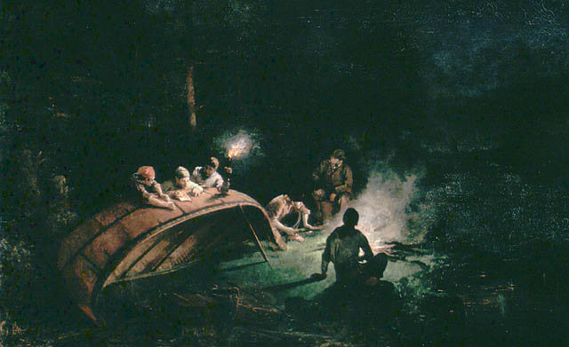 Colour oil on canvas of a small bonfire in the woods at night while six figures sit around it, three of whom are leaning forward  over the back of a canoe that is lying on the ground.