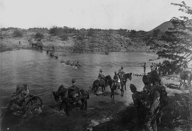 Troops of the Royal Canadian Regiment crossing Paardeberg Drift. (item 1)