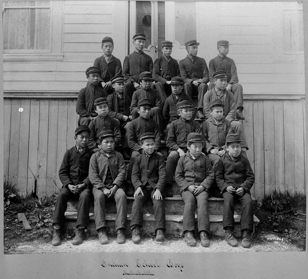 Metlakatla Indian Residential School, group of students posing on outside steps, date unknown