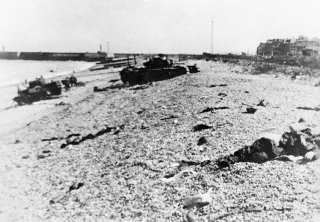 View looking east along the main beach at Dieppe, showing damaged Churchill tanks of the Calgary Regiment. (item 1)