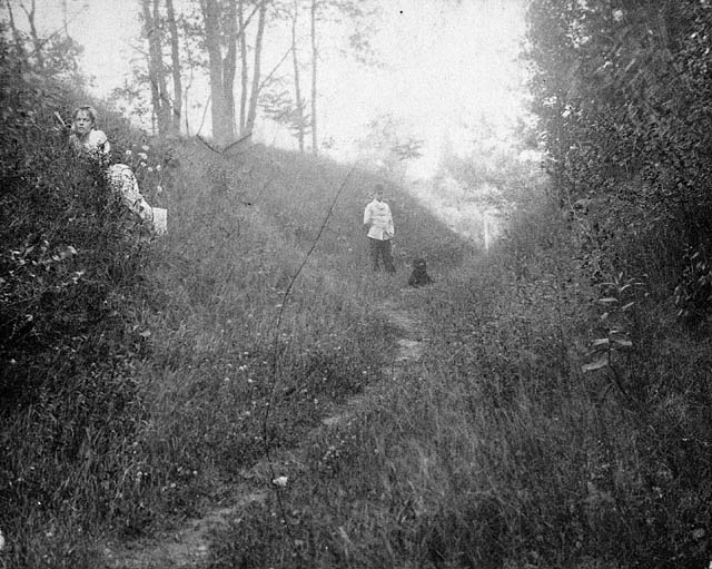 W.L. Mackenzie King and his sister Janet King on Lovers' Walk path at Woodside. (item 1)