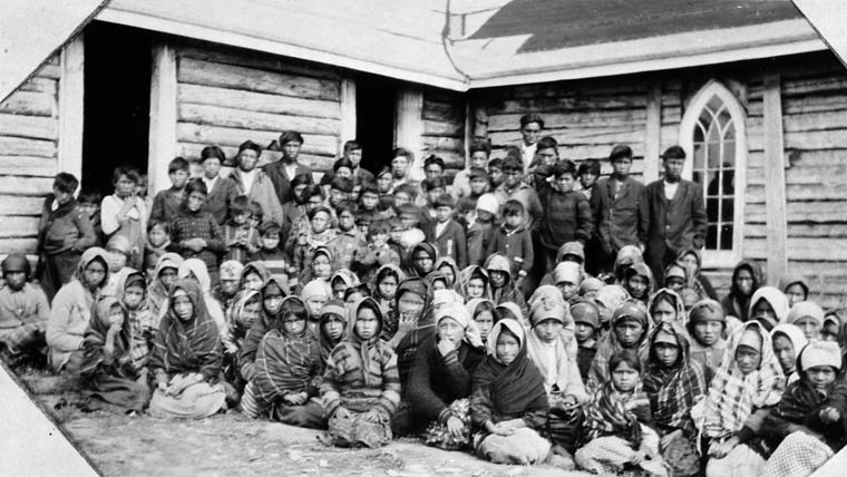 Big Trout Lake Indian Day School, group of students pose outside the chapel, Big Trout Lake [1930]