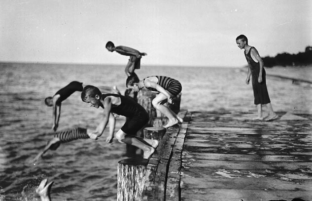 Boys diving off a pier. (item 1)