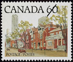 White 60-cent stamp with a colour illustration of a street lined with rowhouses, parking meters, and tall buildings in the background
