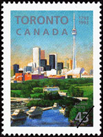 White 43-cent stamp with a colour illustration of a city skyline in the background and waterfront with a park in the foreground