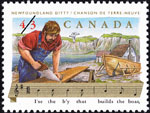 White 43-cent stamp with a colour illustration of a man building a boat, water and cliffs in the background, and music notes and lyrics at the bottom