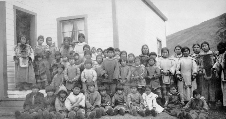 Pangnirtung (Pangnirtuuq) Federal Hostel, group of women and children outside the school, 1927