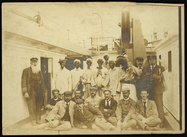 Foredeck Follies. Photo of crew dressed up in costume for a minstrel show (aboard S.S. Faraday?).