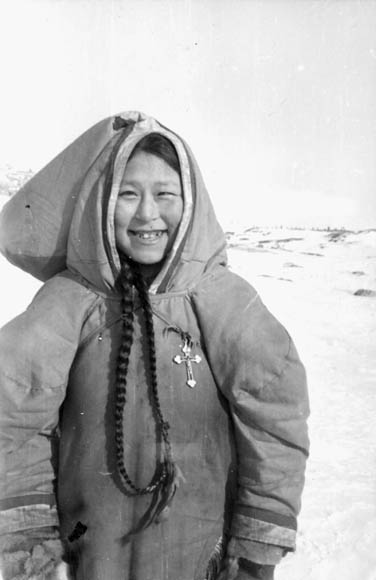 Young Inuit girl with long braided hair wearing a parka. (item 1)