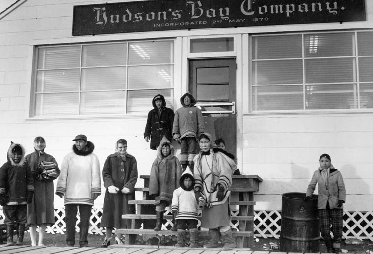 Group of Inuit standing in front of the Hudson's Bay Company outpost at Frobisher Bay, N.W.T. (item 1)