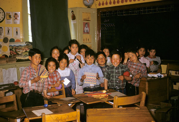 Coppermine (Kugluktuk) school (Tent Hostel), group of children in a weaving class  [1958]