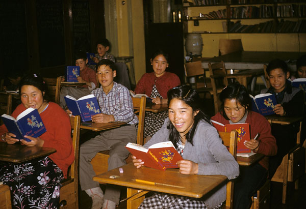 Coppermine (Kugluktuk) school (Tent Hostel), class of senior students reading at their desks  [1958]
