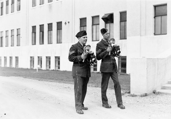Sergeants Burt Johnson and Jack Dalgleish, both of the Royal Canadian Air Force's Press Liaison Section