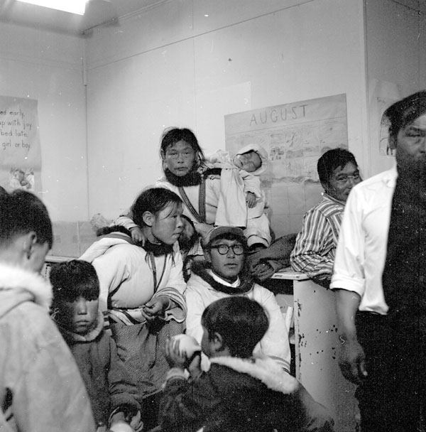 Cape Dorset (Kinngait) Federal Hostel, parents with their children at the school where one of their dances was held, August 1961
