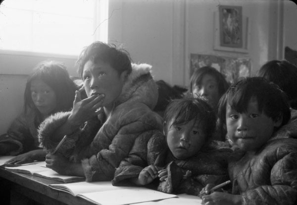 Eskimo Point (Arviat) Federal Hostel, students seated at their desks in a classroom, date unknown