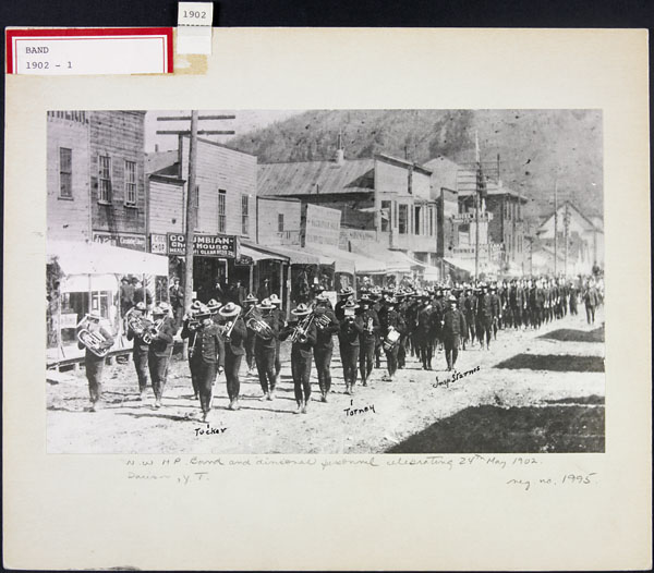 NWMP Band and Personnel, Victoria Day Parade, May 24th, 1902, Dawson, Yukon Territory. (item 1)