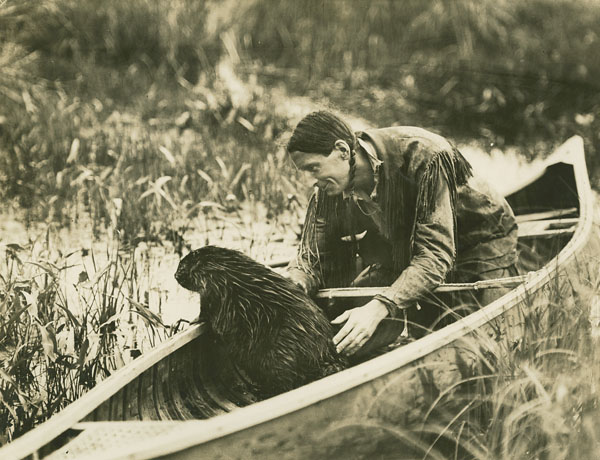 MIKAN 3348586 Beaver in canoe with Grey Owl.