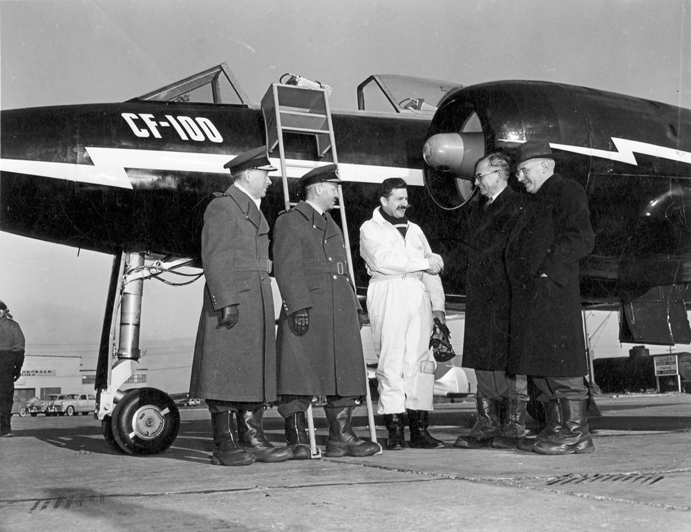 Ministers Curtis and Claxton with others in front of the CF 100, between 1945 and 1951.