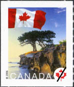 White stamp with a colour illustration of trees on a rocky coastline and a Canadian flag in the top left corner