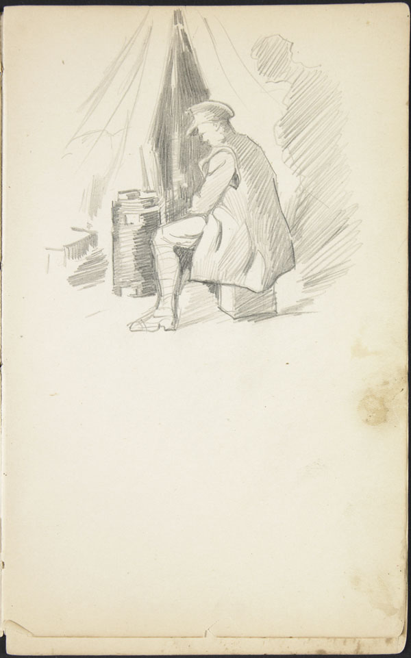 Soldier seated near the entrance of a tent, Somme