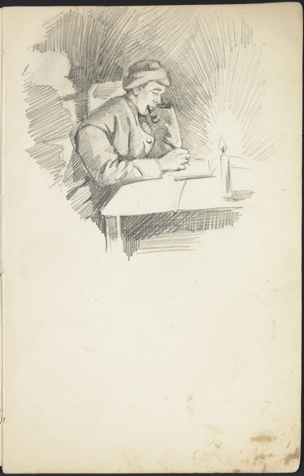 Soldier writing at a table while smoking a pipe, Somme