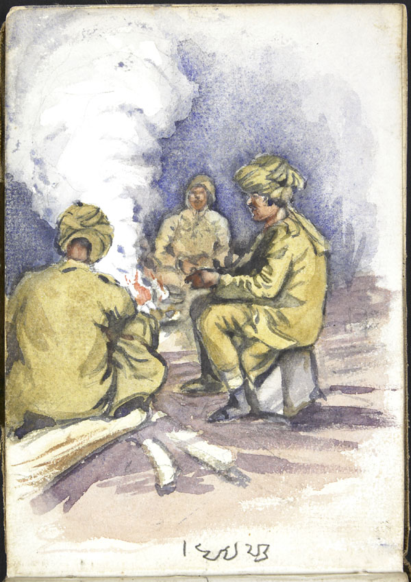 Three soldiers of the Indian Army seated around a fire, Somme